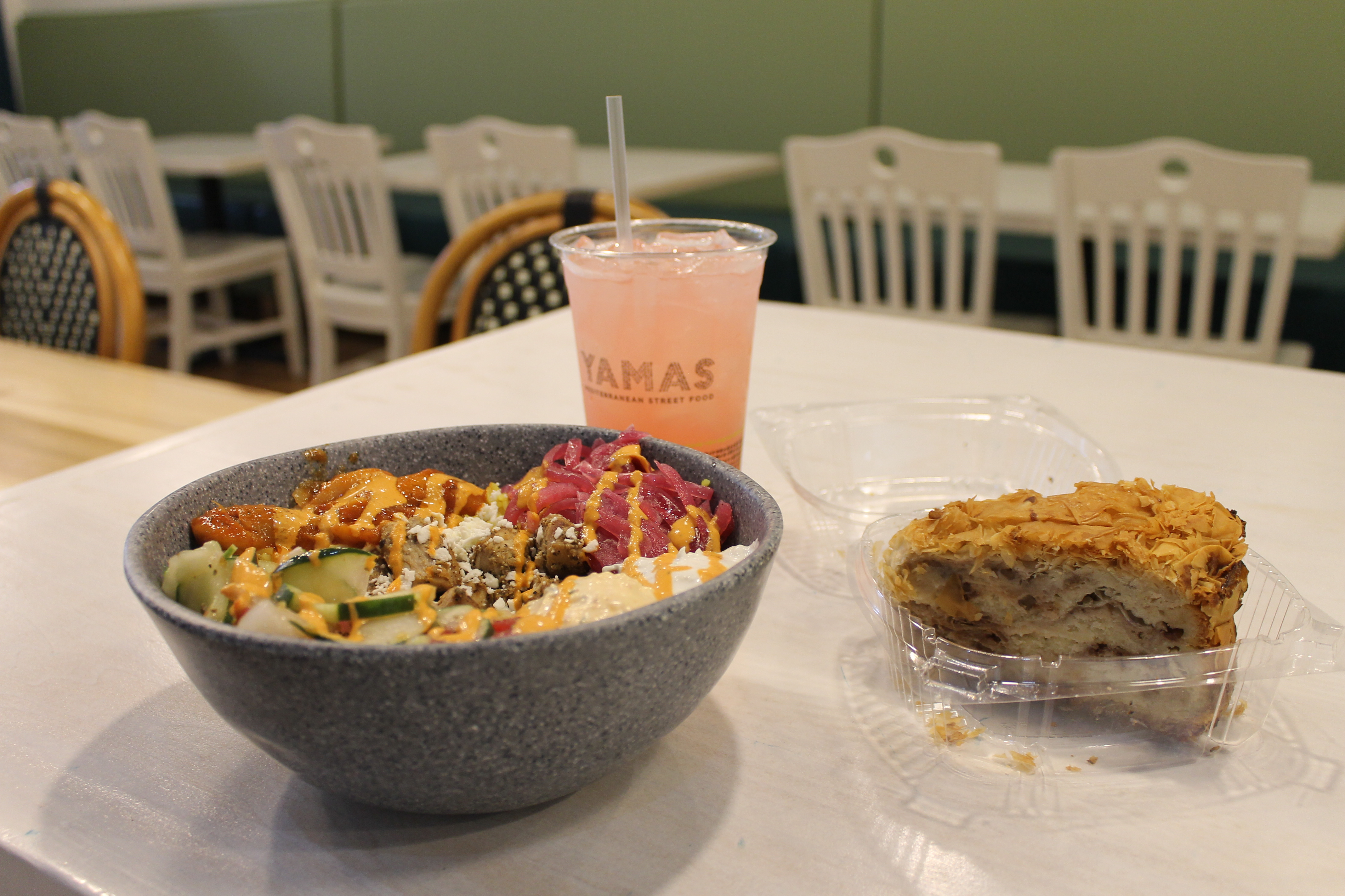 colorful chicken and rice bowl with side and pink rose tea