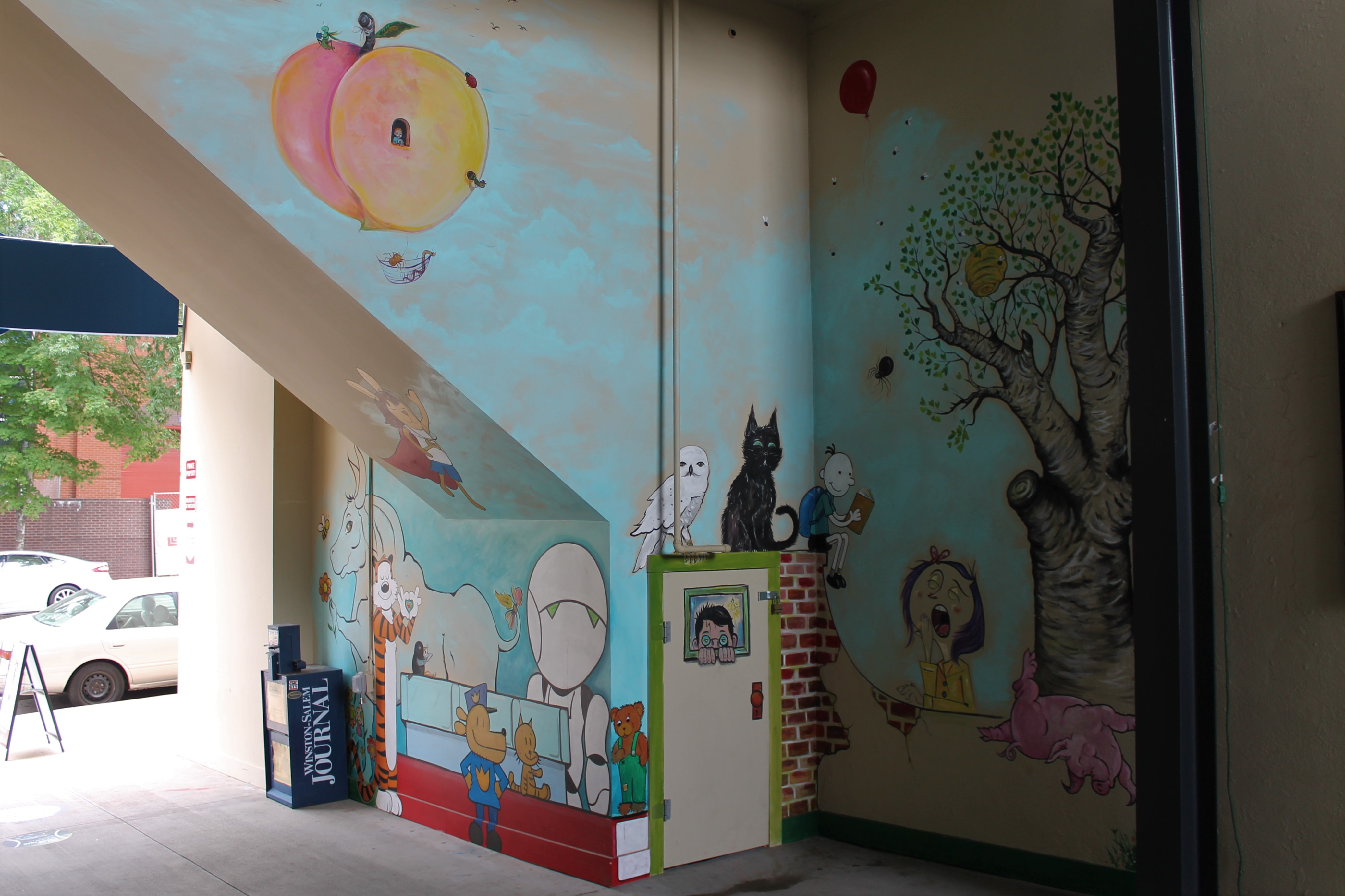 Story book mural with coraline and harrypotter