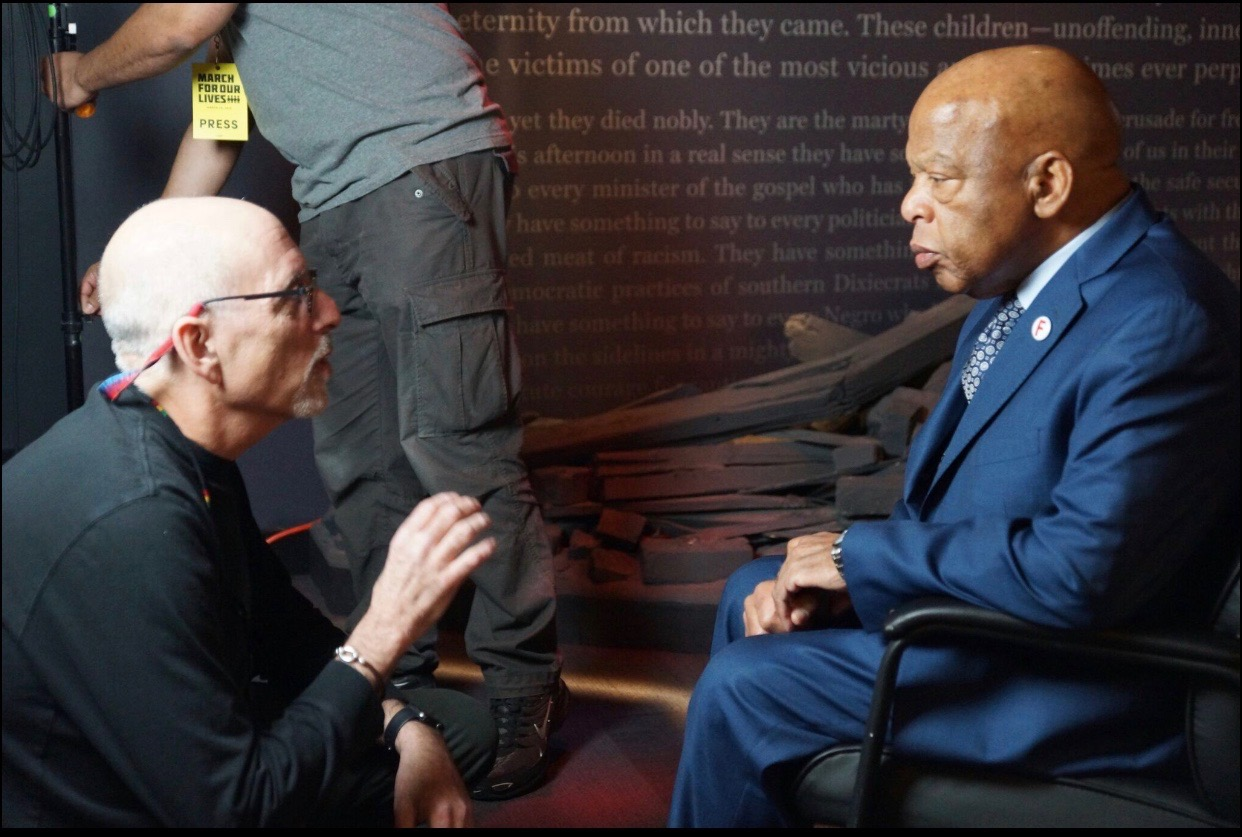 Peter Gilbert filming with Congressman John Lewis at the March for Our Lives Rally.