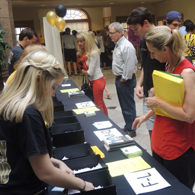 Families check in at the registration area in the Benson Center during Family Weekend