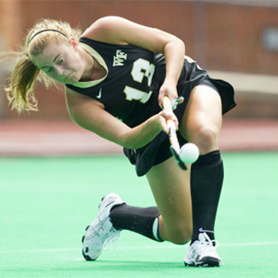 WFU Field Hockey player takes a shot