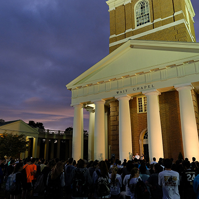 A gathering in front of Wait Chapel