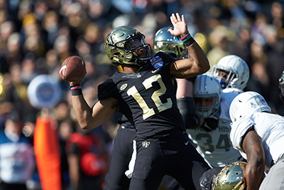 A Demon Deacon Football player throws the ball