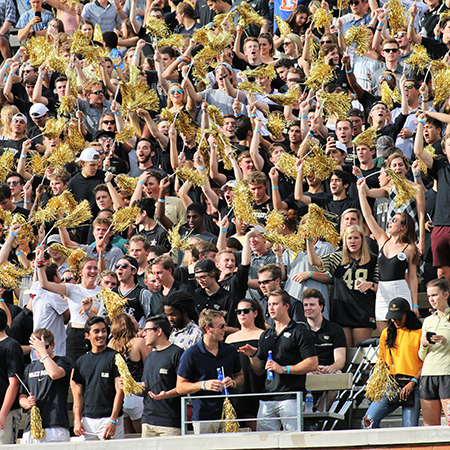 Demon Deacons Football vs NC State - WFU Students cheer on the Demon Decons with gold pompoms