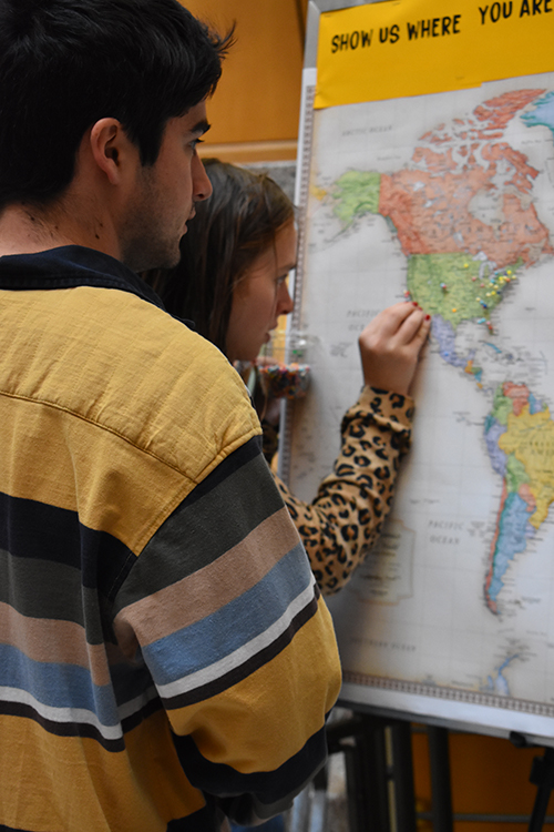 Visitors put a pin in a US map to show how far they traveled to Family Weekend