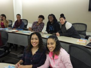 Happy students smile at the camera during a College LAUNCH session.