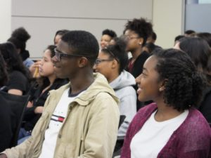Students listen to an instructor during a College LAUNCH session.