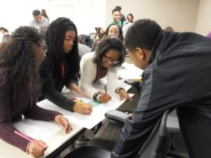 Students collaborate during a College LAUNCH classroom exercise.