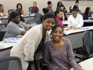 Student and instruction smiling during College LAUNCH session.