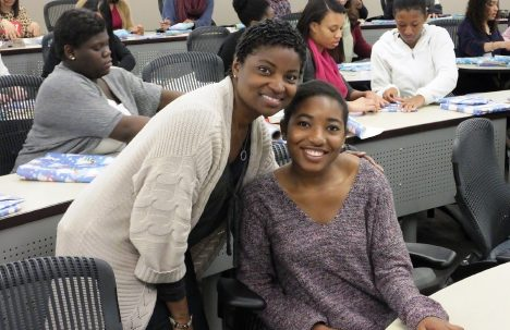 Student and instructor smiling at the camera during a College LAUNCH session.