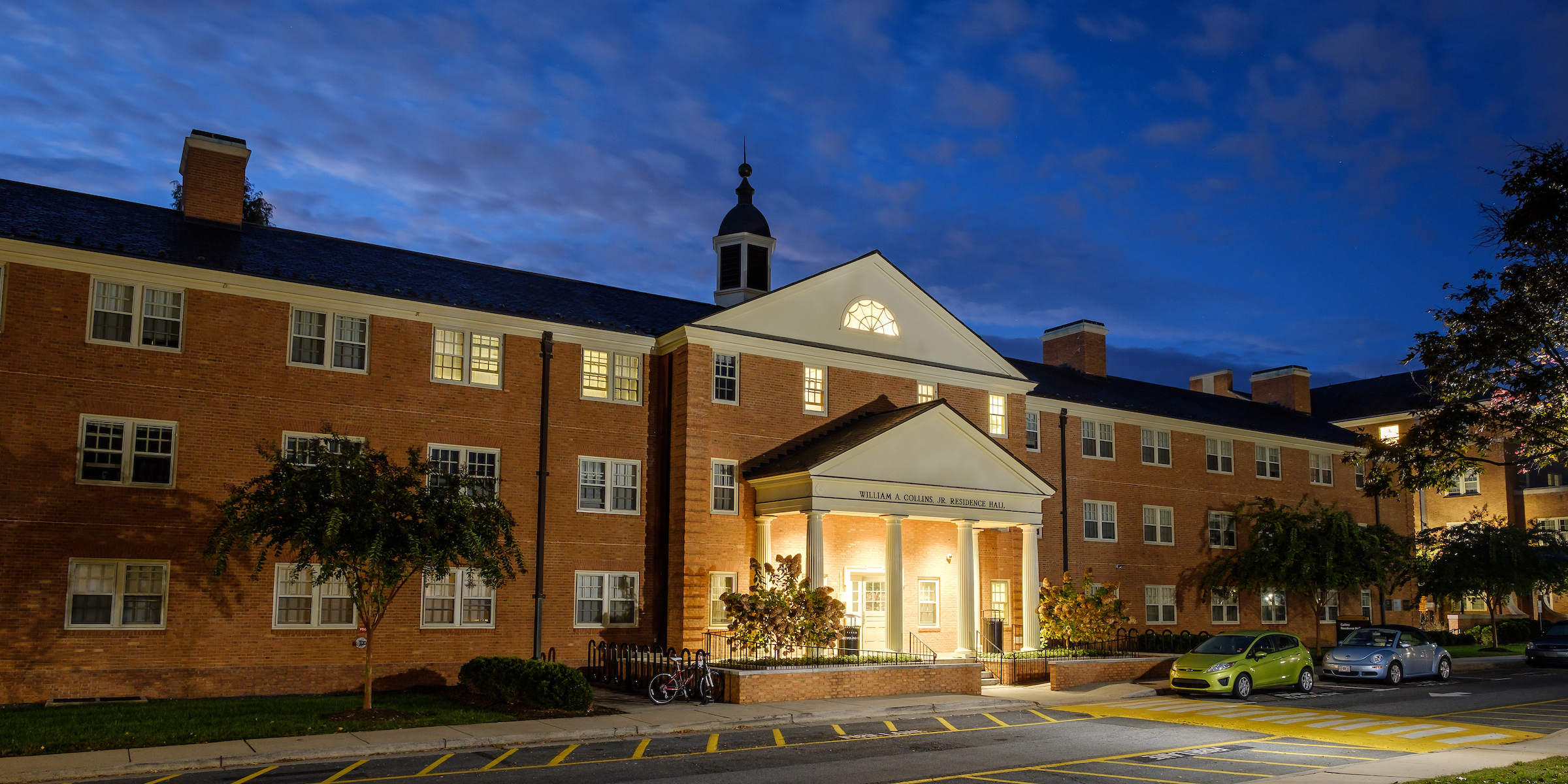 View of Collins residence hall from the street at night