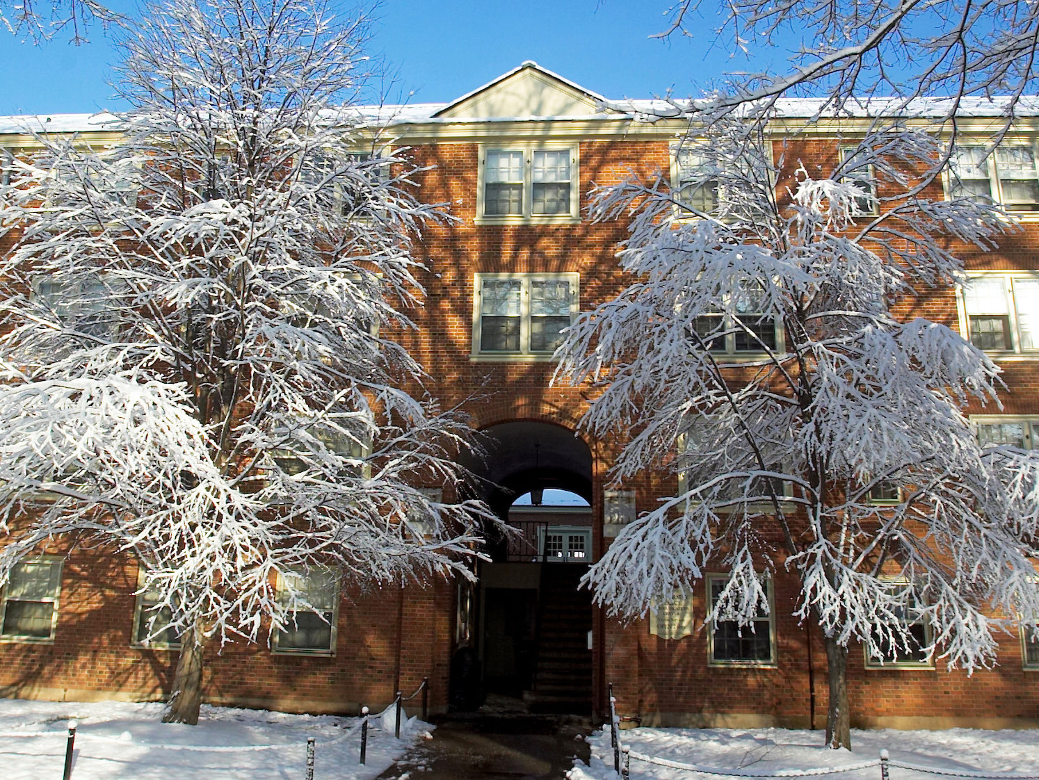 Exterior photo of Davis residence hall after a snow storm