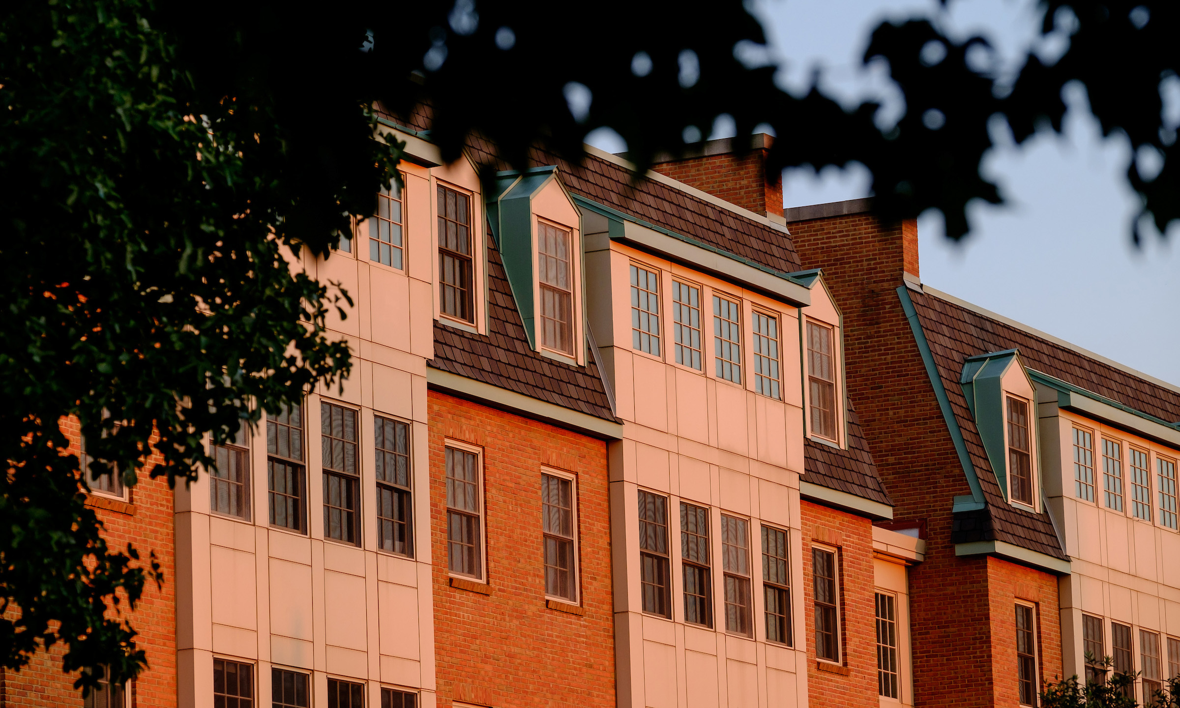 Photograph of Polo Residence hall at sunset