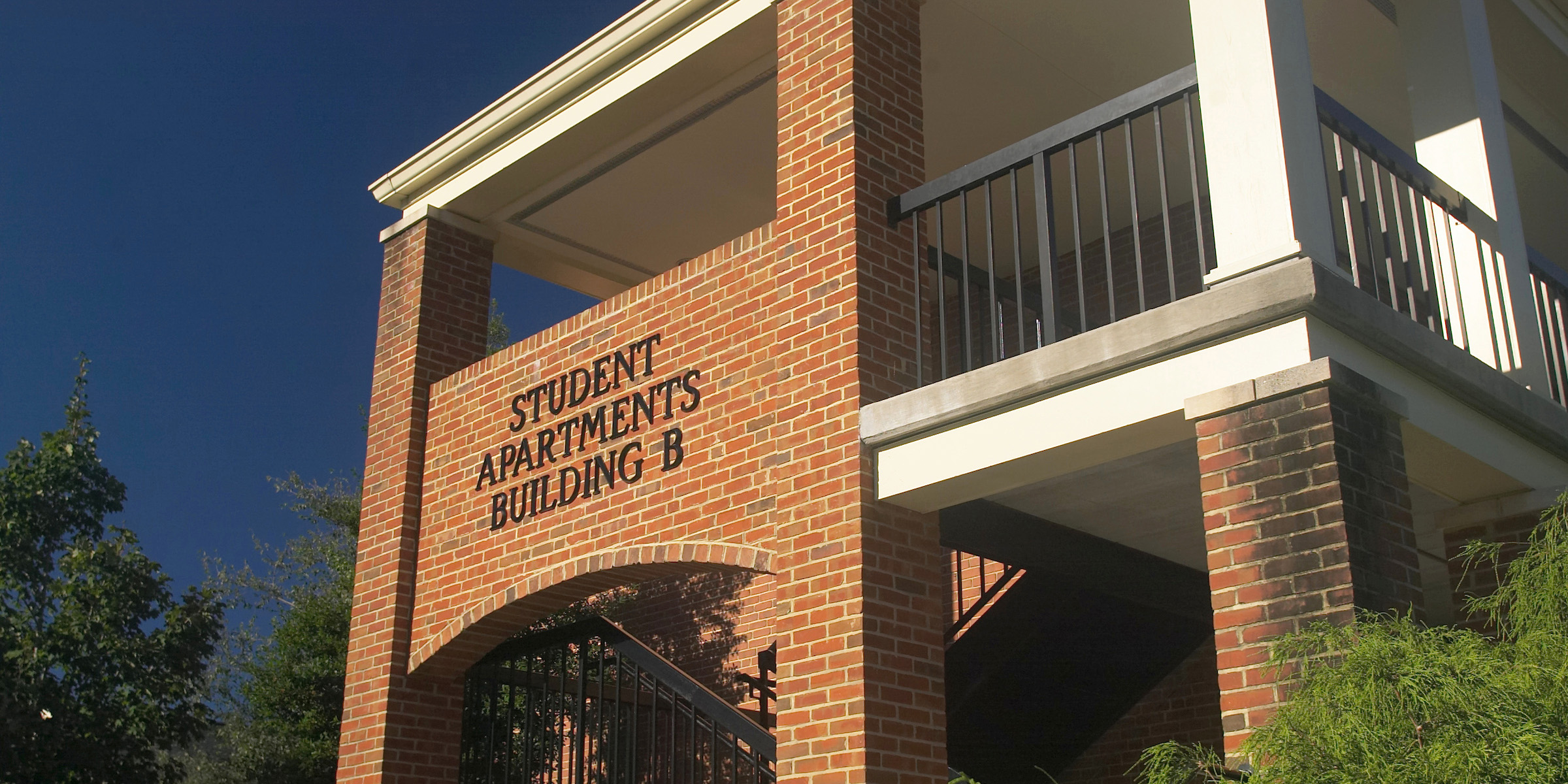 Photo of the sign to Student Apartment Building