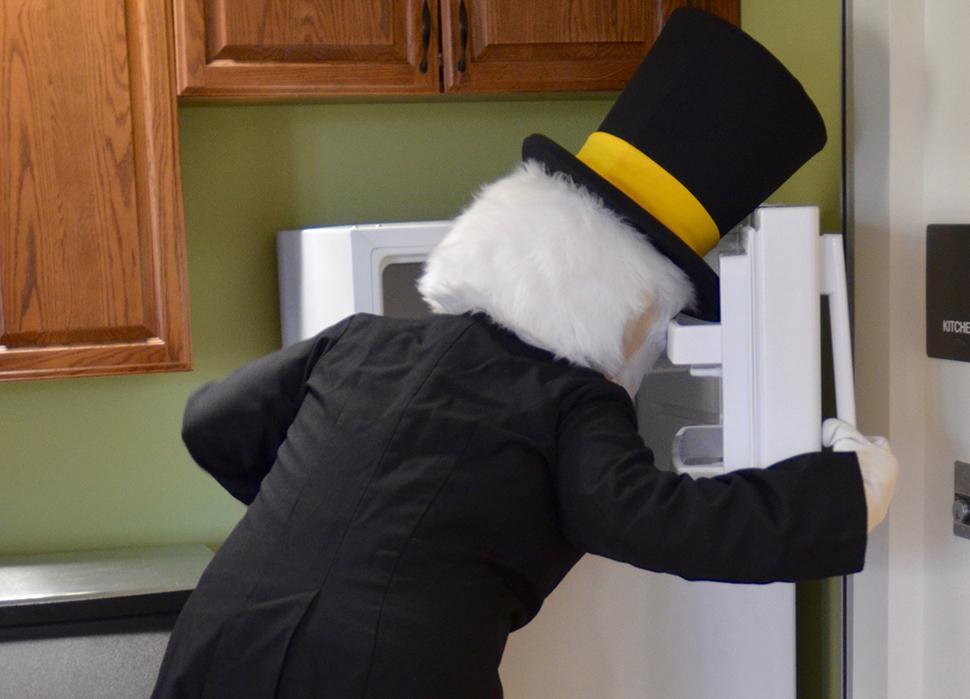 Deacon reaching in the freezer