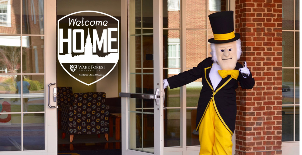 The demon deacon holding a door open, with the Welcome Home logo