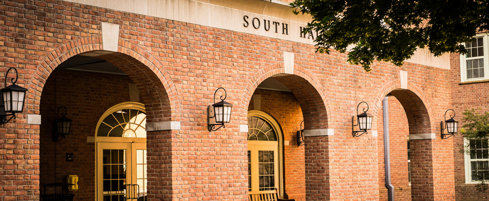 Exterior photo of the front entrance into South Residence Hall