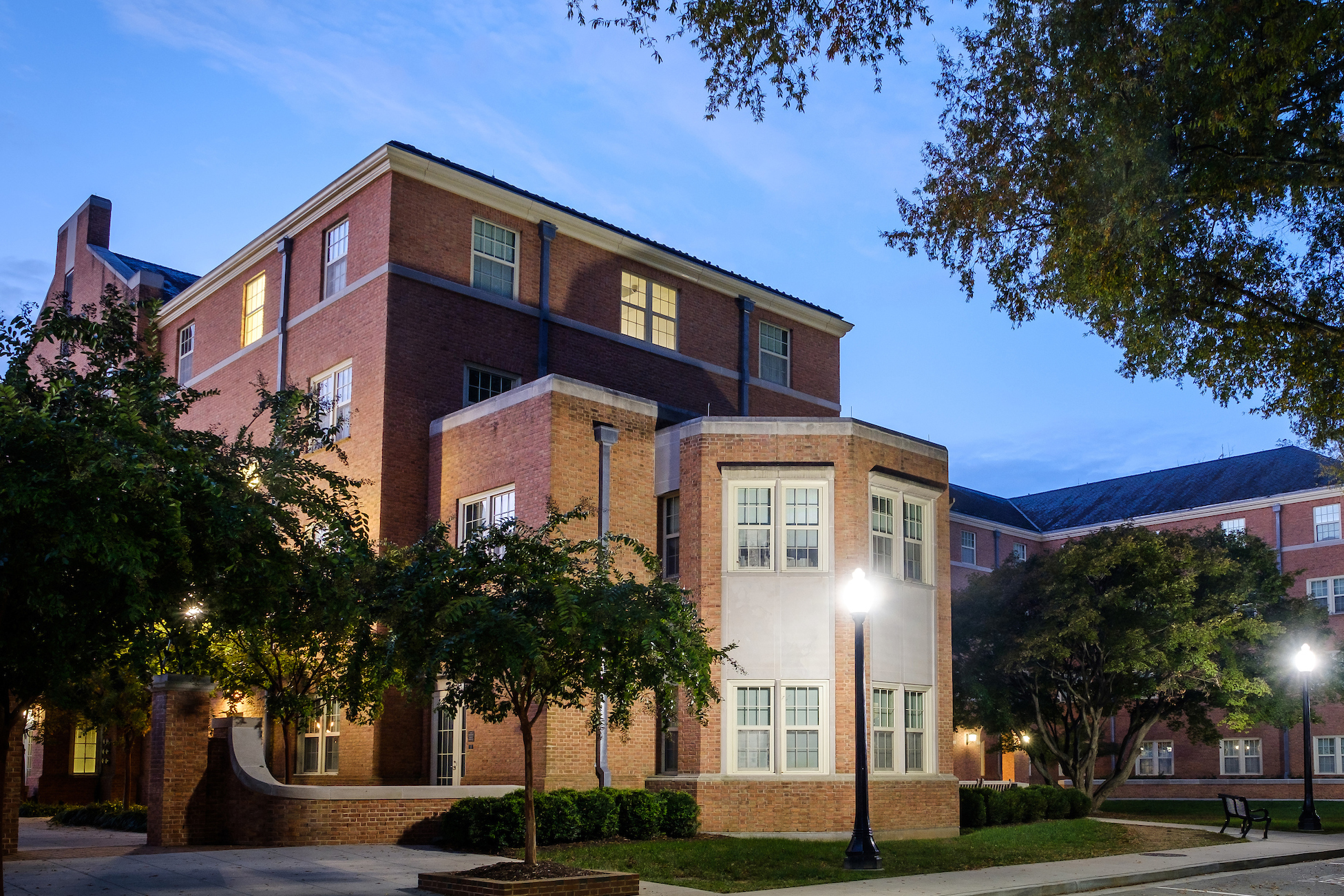 Exterior photo of South Residence Hall at dusk