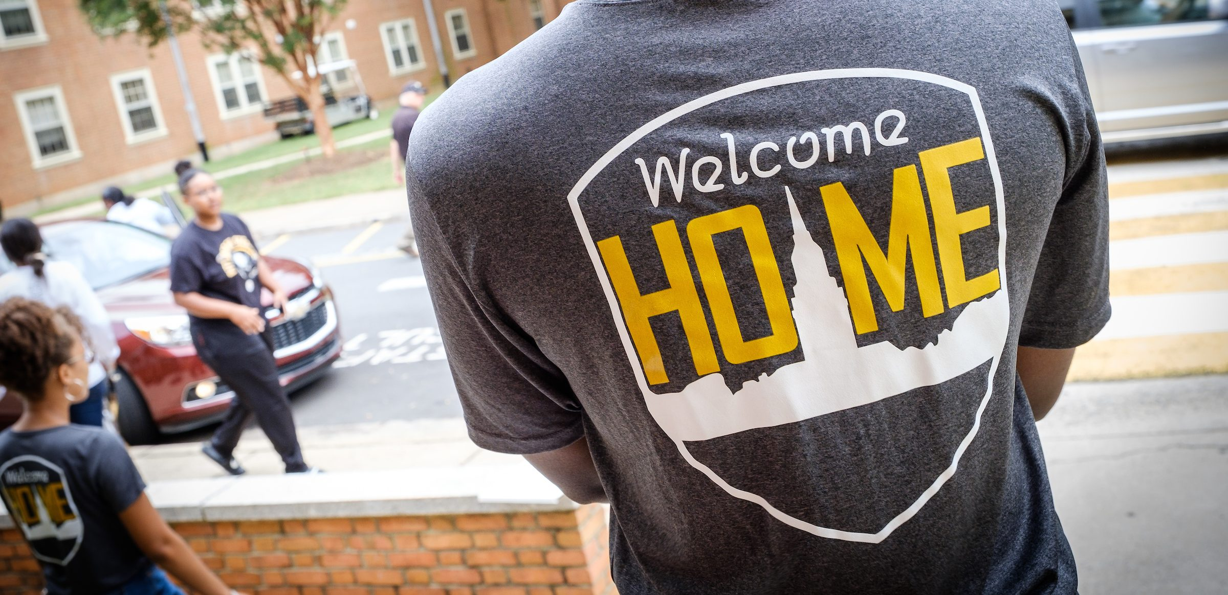 The Welcome Home logo as photographed on a tshirt of an RA during move in day