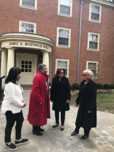 A photo of the distinguished alum outside of Bostwick Hall before their tour
