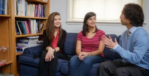 Wake Forest students talk with their adviser.