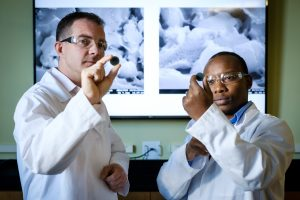Principal investigator Michael D. Gross, Ph.D. (pictured above, left) and Sixbert P. Muhoza, Ph.D., (right) postdoctoral research scientist