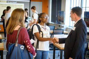 Students meeting faculty