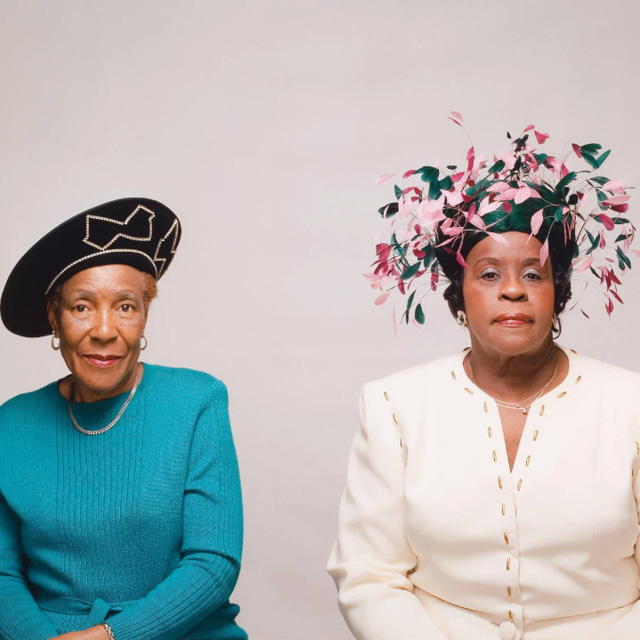 two women with extravagant hats