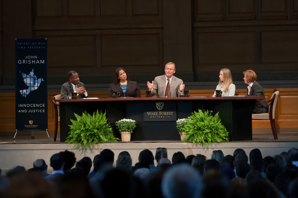 Legal writer John Grisham participates in a panel discussion on innocence issues as part of the Voices of Our Time series in Wait Chapel at Wake Forest University on Tuesday, September 14, 2010. The panelists, from left, law school dean Blake Morant, law student Mimi Kendrick (JD '11), John Grisham, law student Jessica Hollenbach (JD '11), and law professor Carol Turowski, the Co-Director of the Innocence and Justice Clinic at the law school.