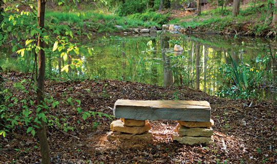 stone bench by a pond