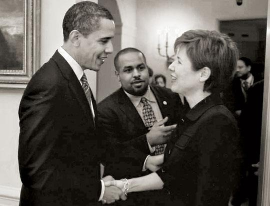 Melissa Rogers shakes President Obama's hand.