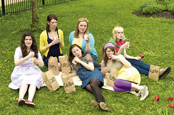 group of women eating in a park