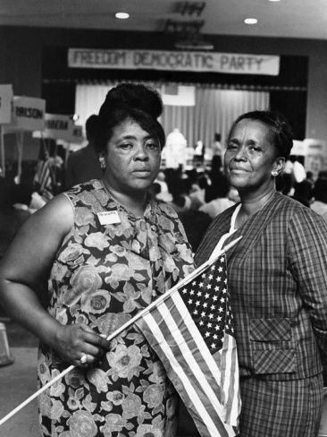 """This image of Fannie Lou Hamer and Ella Baker was taken at the Mississippi Freedom Democratic Party's state convention on August 6, 1964. The convention was attended by nearly 2,500 black Mississippians who were addressed by Stokely Carmichael. While speaking, Carmichael would say that those assembled that evening were testaments of the """"sacrifice, blood, and struggle"""" for denied rights. Ella Baker gave the convention's keynote address, stressing the importance of education in the Black Freedom Struggle."""