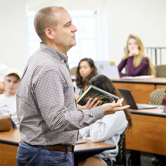 Wake Forest students in the First Year Experience class have a wide ranging discussion of the liberal arts, AP class credit, divisional requirements, and required language classes