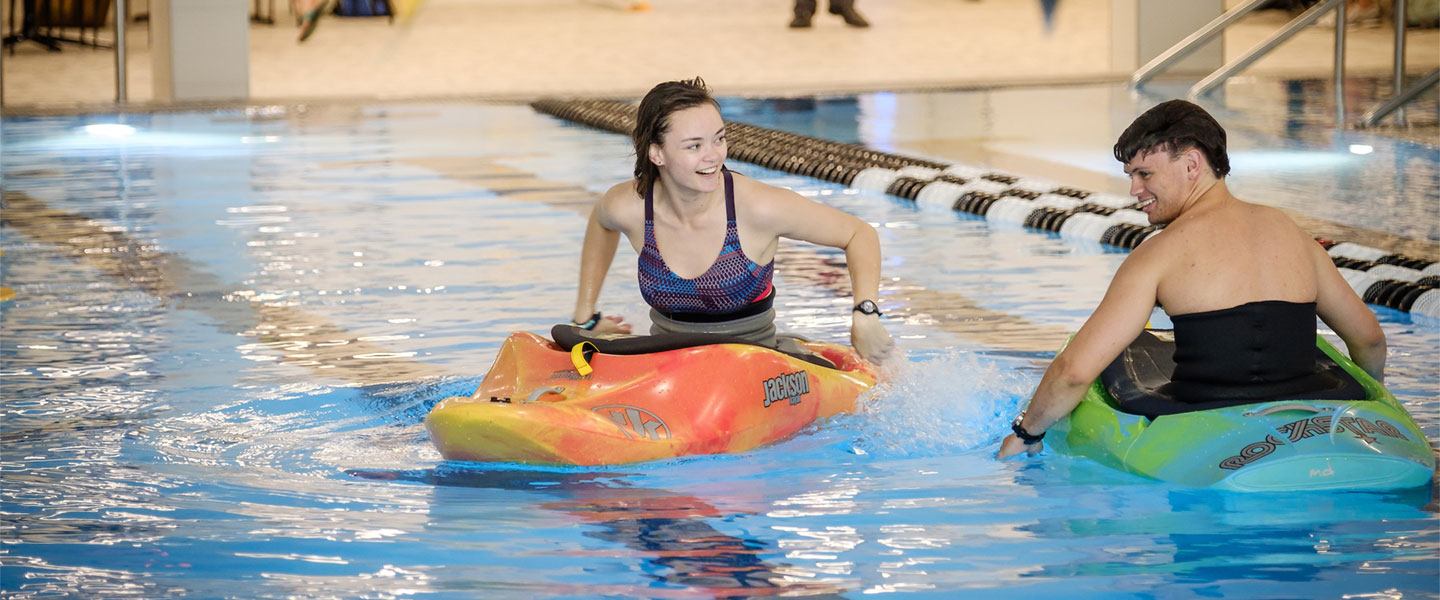Students kayaking in the pool at Reynolds Gym