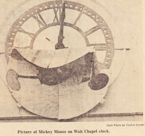 Newspaper photo showing Mickey Mouse on the Wait Chapel clock.