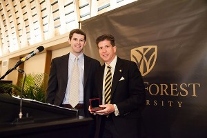Wills Denton ('10) accepting the award on behalf of his late father, Graham W. Denton Jr.