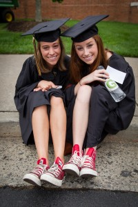 Sydney Shirley and Meggy Hearn show off their red Chuck Taylor sneakers, worn by the graduating members of Chi Omega sorority.