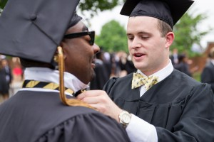 Mark Covington ('13) gets a little help with his bow tie from Landon Baucom ('13).