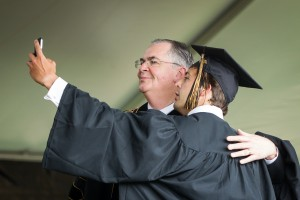 Chad Brady takes a self portrait with President Hatch as he crosses the stage.