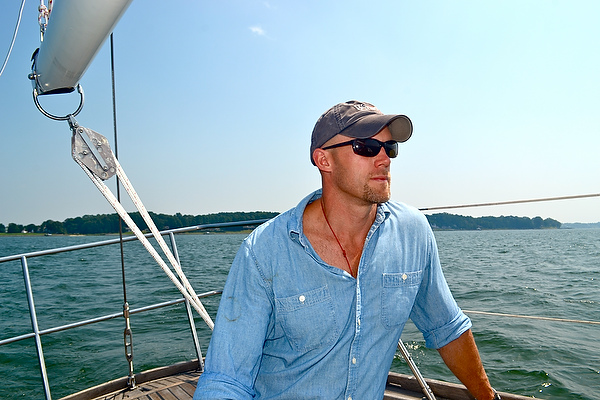 Rob Cocke on his sailboat, Trilogy