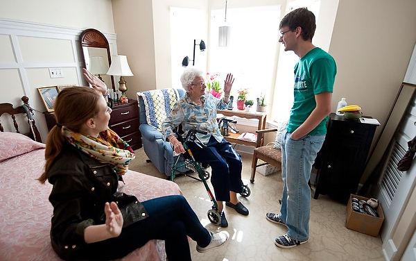 "Brookridge Retirement Community resident Fern Daniel, 100 years old, gives 20-something students Torey Styer and Joseph Belangia some advice for a long life: ""Take the good with the bad, exercise and go to church."""