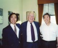 'We worship him,' say Augi (left) and Yuki (right), shown here with Dr. Wilson when he was provost.