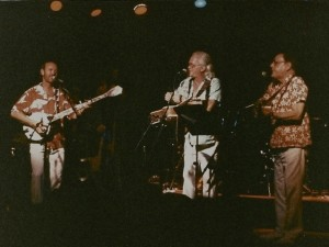 George Grove (left) performing with original members of The Kingston Trio Bob Shane (center) and the late Nick Reynolds.