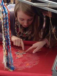 Lauren Gaston participates in a Qing Dynasty embroidery workshop at Beijing Institute of Fashion Technology.