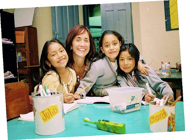 Julie Coyne ('89) with children served by Education and Hope in Guatemala
