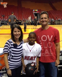 Danny Borrell and his wife, Martha, with Dream Kid Zachyus Bowers, who wanted to see a Miami Heat game.