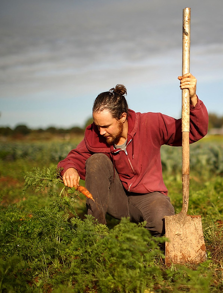 Isaac Oliver grew up hunting and fishing but now harvests carrots.