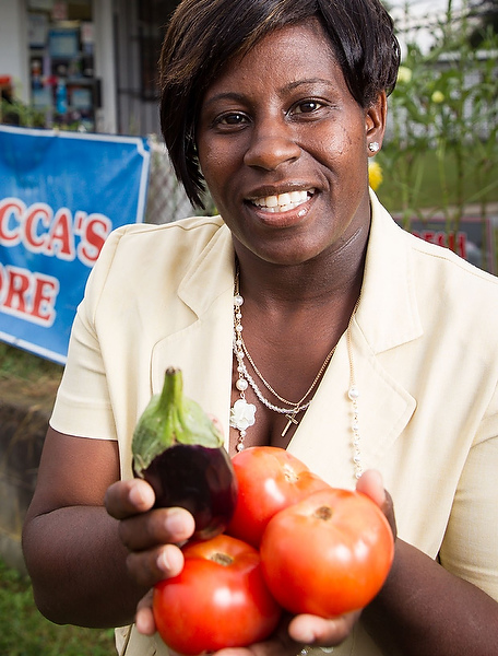 Tamica Patterson (MDiv '16) shows fruits and vegetables available in her family's Winston-Salem store.