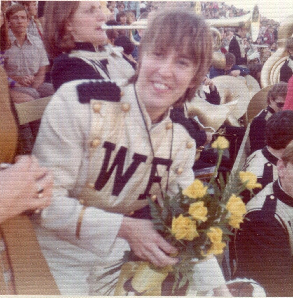President Scales presented yellow roses to Pam Key at her last game as drum major.